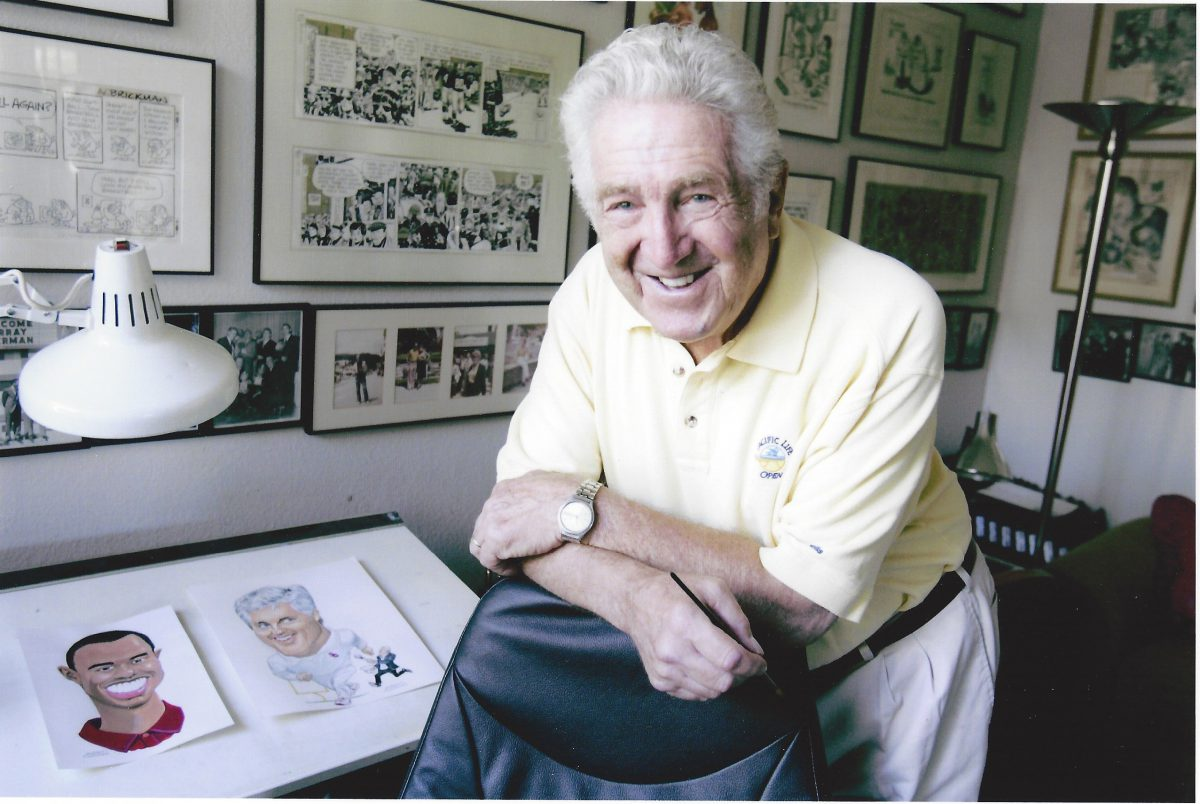 Murray Olderman with some of his cartoons.