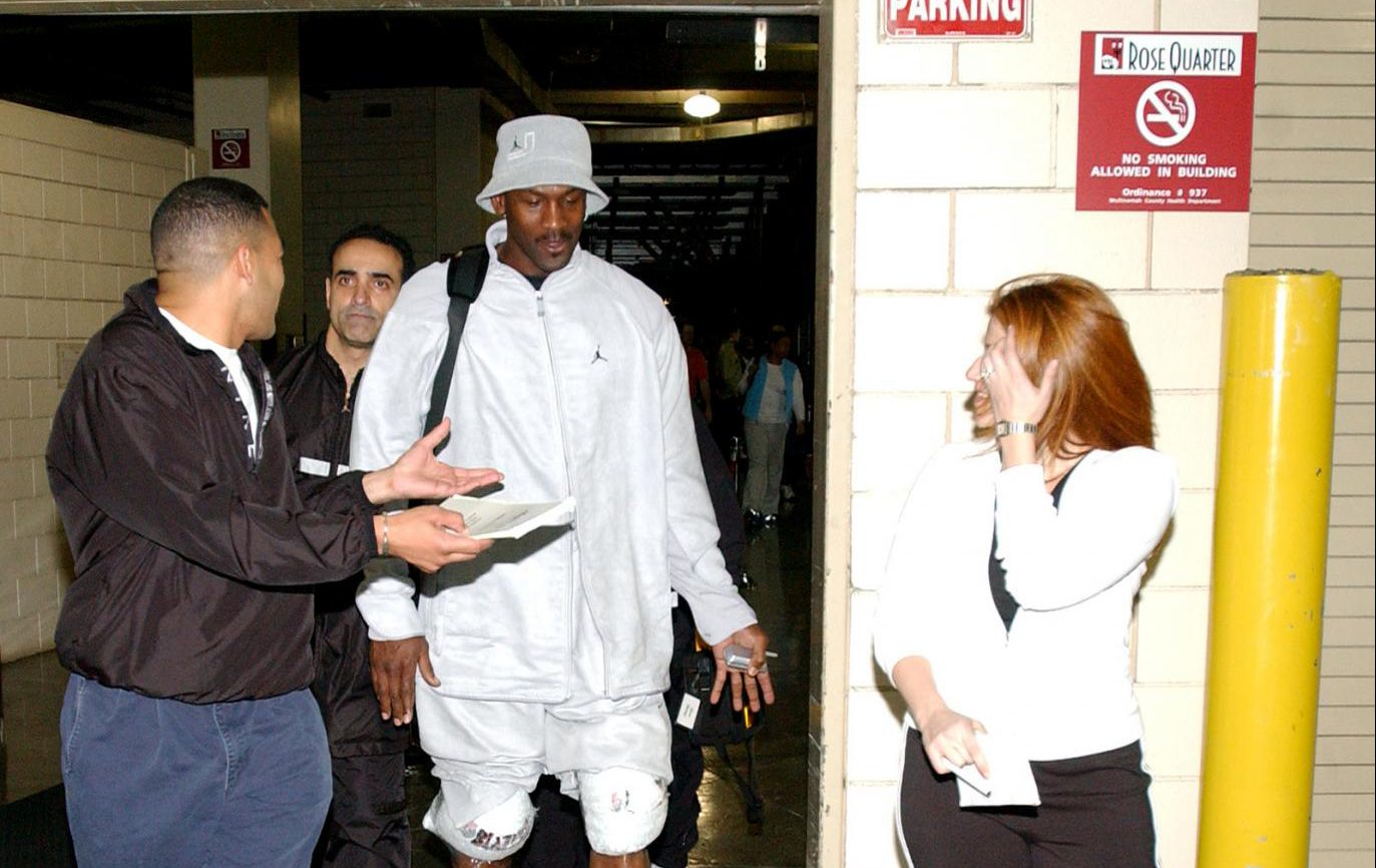 J.A. Adande, Michael Jordan's personal trainer Tim Grover, Michael Jordan and Rachel Nichols, after a Washington Wizards practice in 2003.