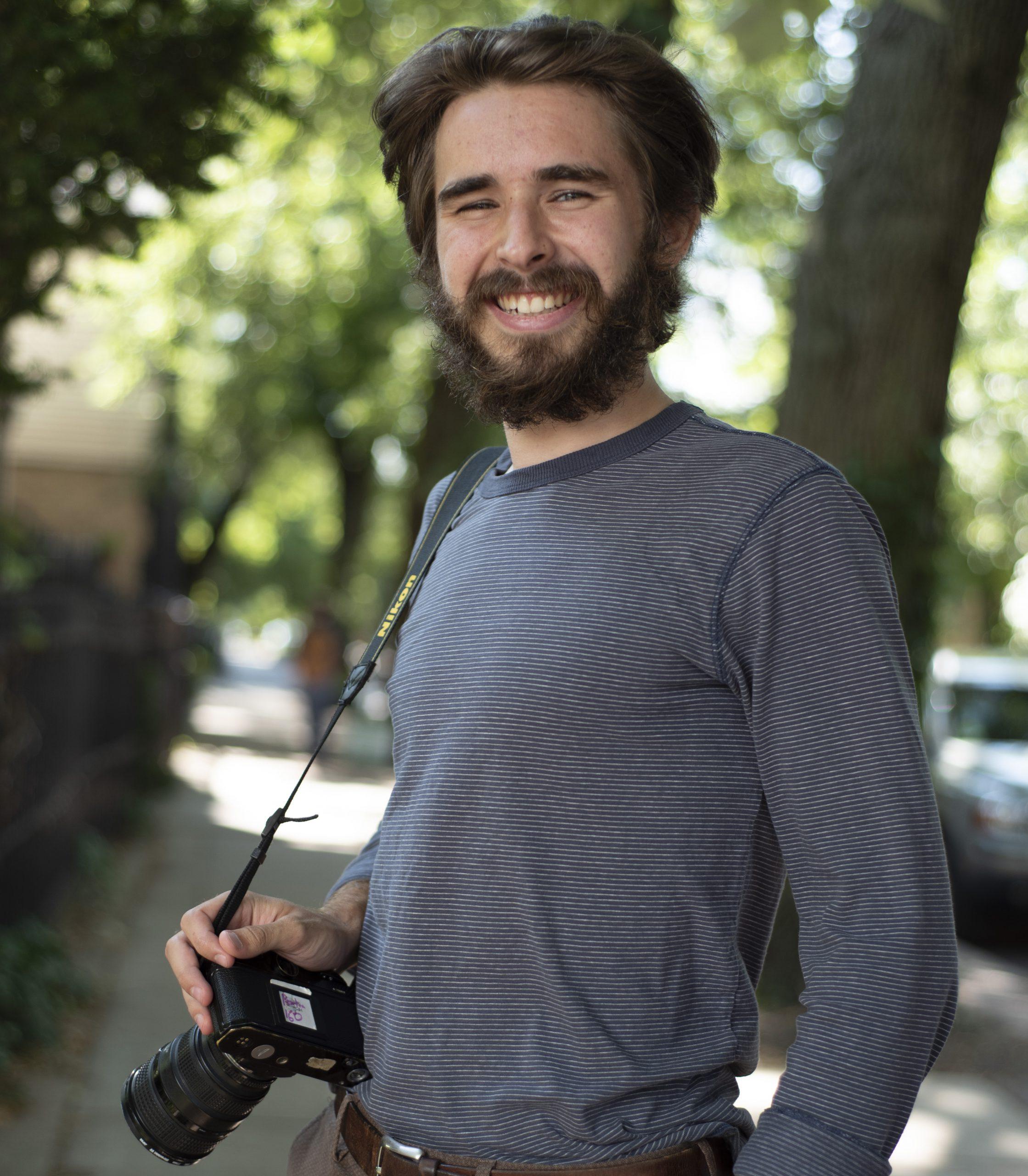 Colin Boyle holding camera.