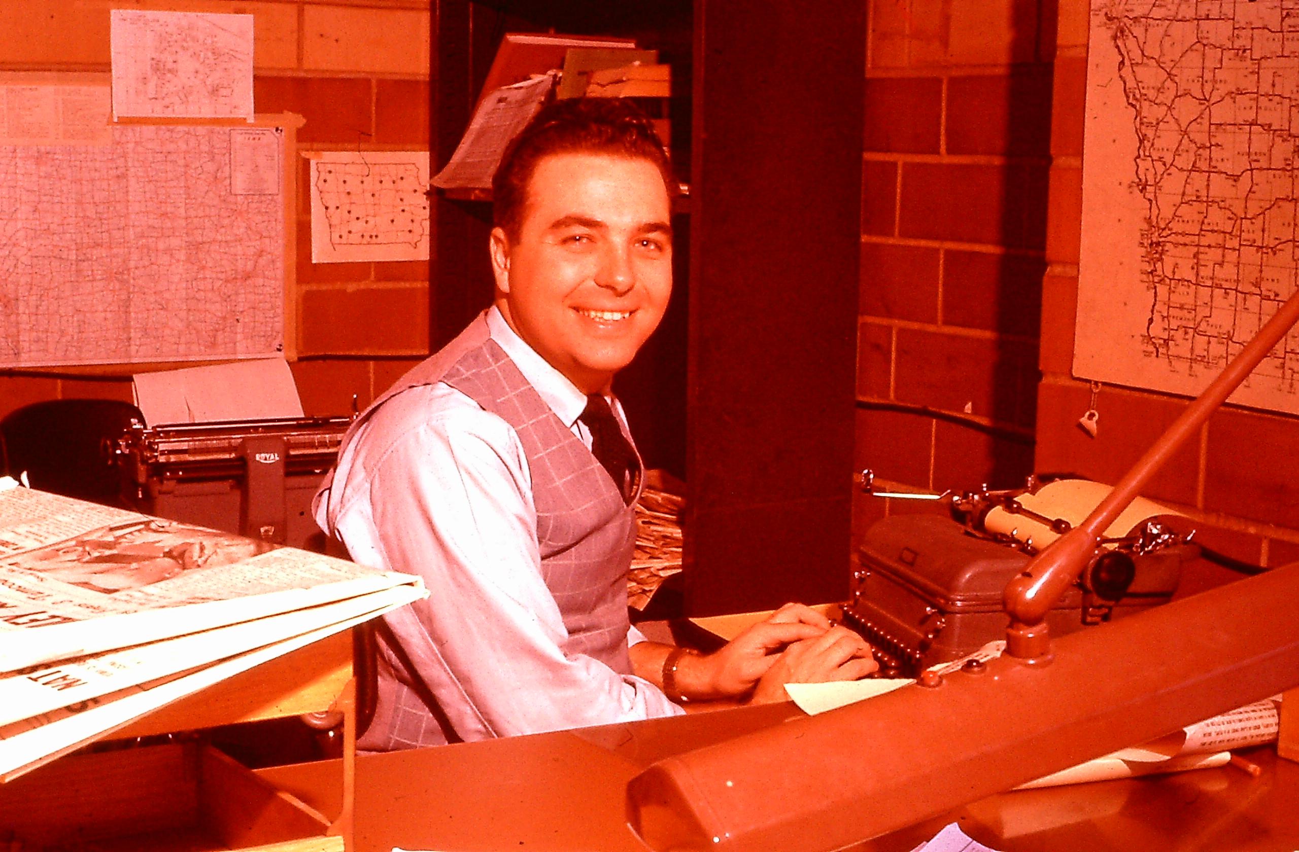 Ray Nelson at typewriter at Medill.